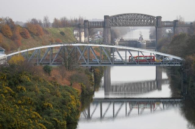 Bus on swing bridge over river (640x423)